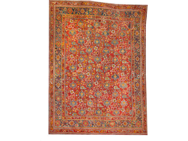 An Oushak carpet  size approximately 10ft. 7in. x 14ft. 8in.