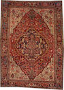 A Heriz carpet size approximately 8ft. 4in. x 11ft. 4in.
