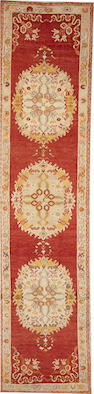 An Oushak runner  size approximately 2ft. 11in. x 12ft. 4in.