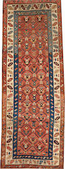 A Kazak rug  size approximately 3ft. 7in. x 9ft. 9in.