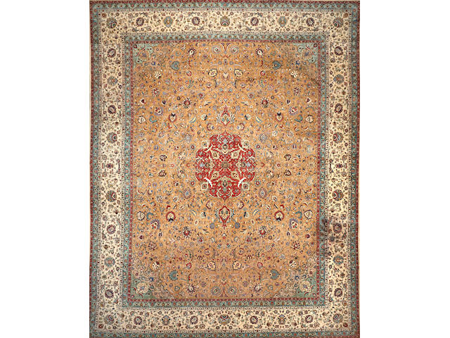 A Tabriz carpet  size approximately 14ft. 2in. x 18ft.