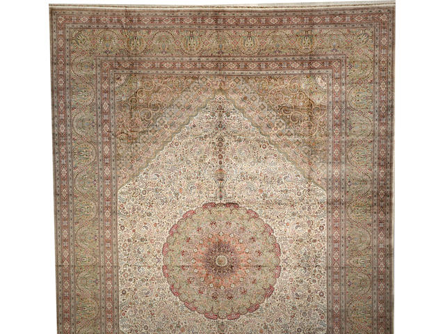 A Chinese silk carpet  size approximately 16ft. x 23ft. 9in.