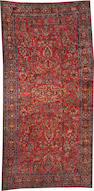 A Sarouk carpet  size approximately 8ft. 11in. x 17ft. 11in.