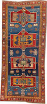 A Kazak runner  size approximately 5ft. 8in. x 12ft. 4in.