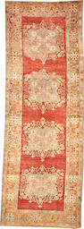 An Oushak runner  size approximately 3ft. 8in. x 10ft. 6in.