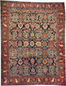 A Heriz carpet  size approximately 8ft. 10in. x 11ft. 3in.