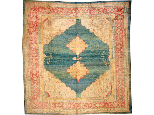 An Angora Oushak carpet (carpet has been reduced) size approximately 9ft. 8in. x 10ft. 1in.