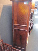 A tall hardwood rounded-corner tapered cabinet