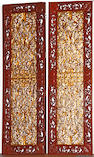 Two massive Chinese gilt and polychrome lacquered wood doors
