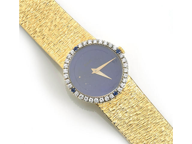 A lapis lazuli, sapphire, diamond and eighteen karat gold integral bracelet wristwatch, Piaget