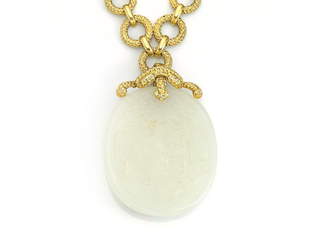 A nephrite and fourteen karat gold pendant/necklace