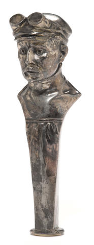 A bust of an early motorist cane handle,
