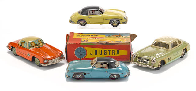 An interesting lot of tin 300SL Mercedes-Benz toy cars
