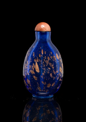 An aventurine-splashed blue glass snuff bottle  Likely Imperial Glassworks, Beijing 1736-1800