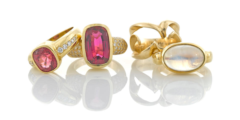 A collection of three gem-set, diamond and 18k gold rings together with a 14k gold ring