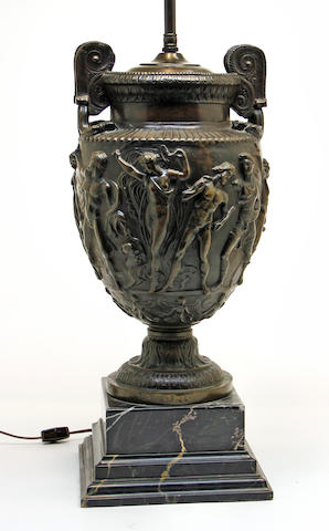 A Neoclassical style patinated bronze 'Townley Vase' on Portor marble plinth, now a table lamp  after the antiquecopied by C. Delpech for the Art Union of Londondated 1871