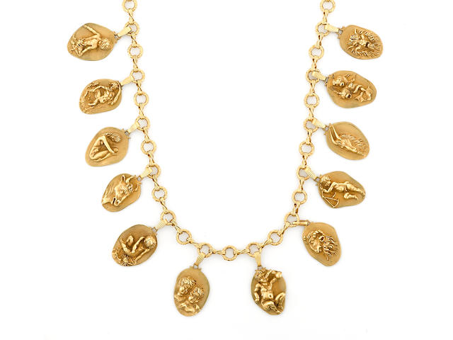 A fourteen karat gold zodiac necklace, Eric de Kolb