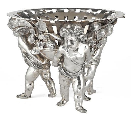 A German 800 standard silver  circular pierced figural pedestal bowl by Storck & Sinsheimer, Hanau,  late 19th/early 20th century
