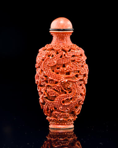 A coral glazed molded porcelain snuff bottle Imperial kilns, 1796-1820