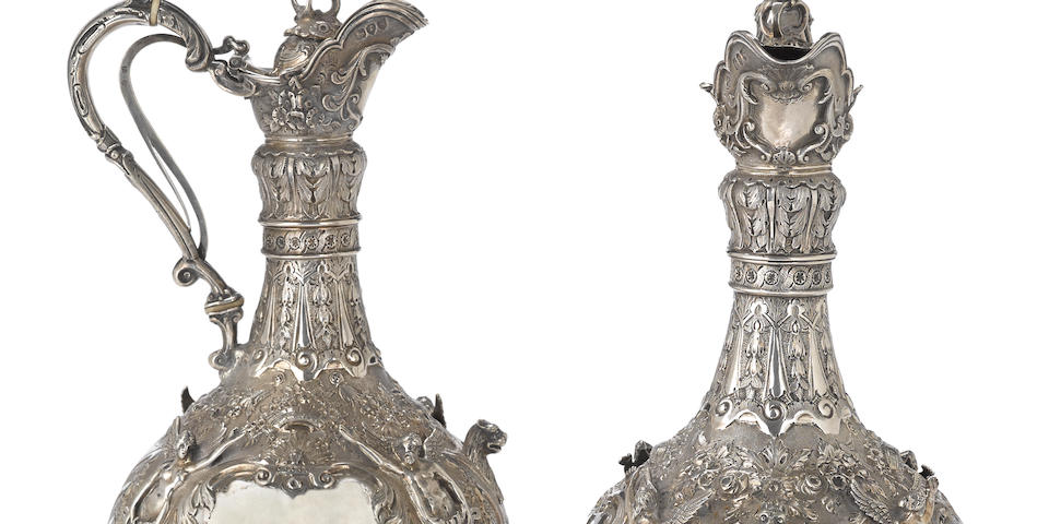 A pair of Victorian  sterling silver  Armada pattern ewers by Robert Martin & Ebenezer Hall, London,  1893