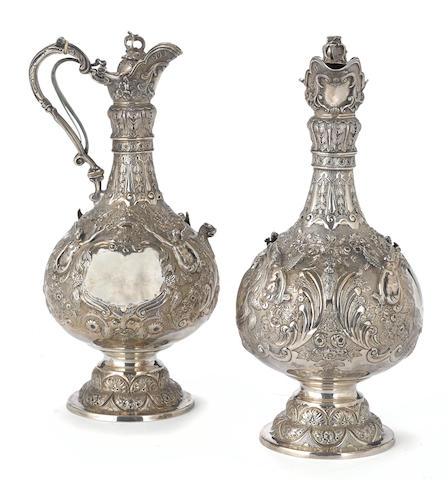 A pair of Victorian  sterling silver  Armada pattern ewers by Robert Martin & Ebenezer Hall, London,  1893
