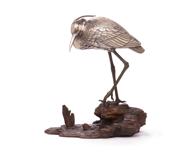 A silver and bronze model of a heron By Yoshiteru, Meiji period (late 19th century)