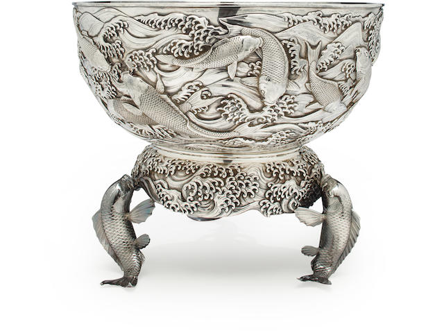 A large silver punch bowl and stand By the Konoike workshop, Meiji period (late 19th century)