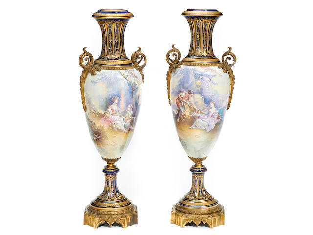 A pair of French gilt bronze mounted earthenware urns late 19th/early 20th century