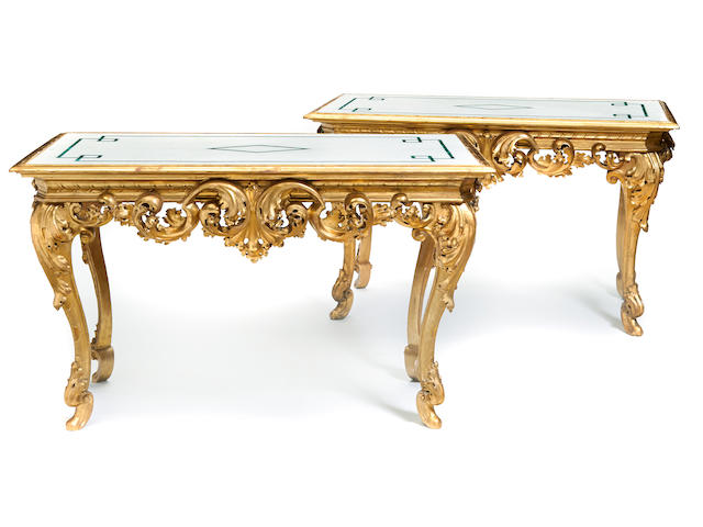 A pair of Italian Rococo style carved giltwood center tables late 19th century