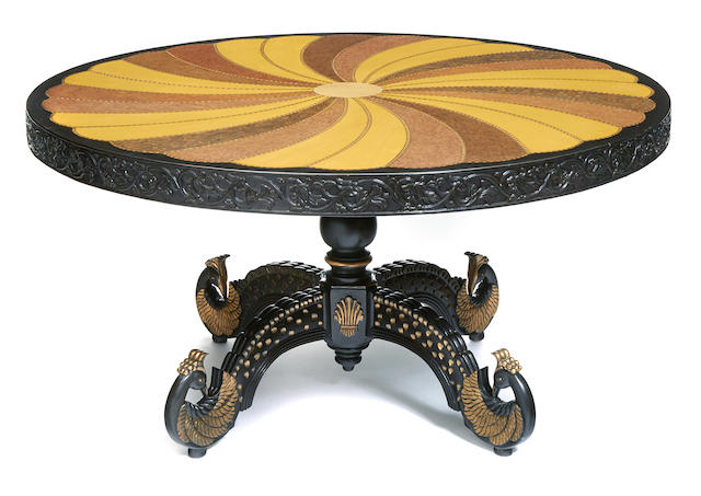 An Anglo-Indian specimen wood inlaid and parcel gilt ebonized center table