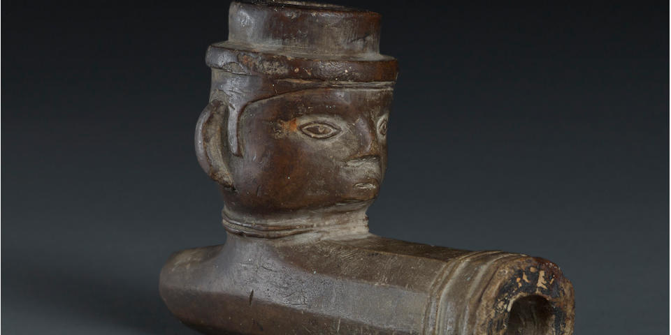 A fine and rare Great Lakes figural stone pipe