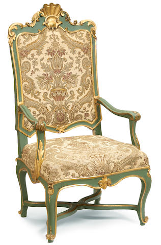 An Italian Rococo parcel gilt and paint decorated armchair mid 18th century