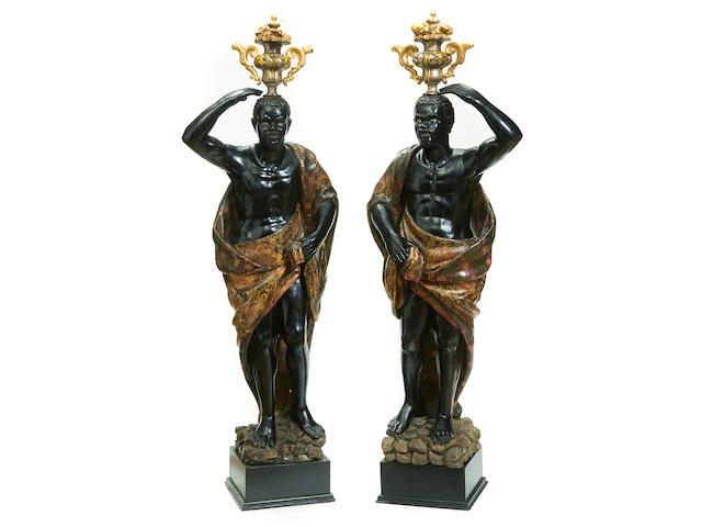 A pair of Venetian Rococo style polychrome decorated and ebonized figures second half 19th century