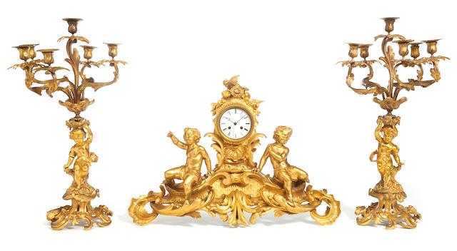 An assembled French gilt bronze clock garniture late 19th century