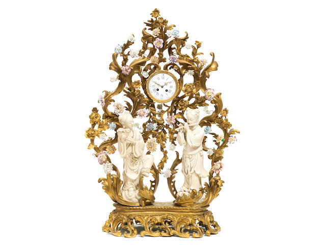 An imposing gilt bronze and porcelain mantel clock