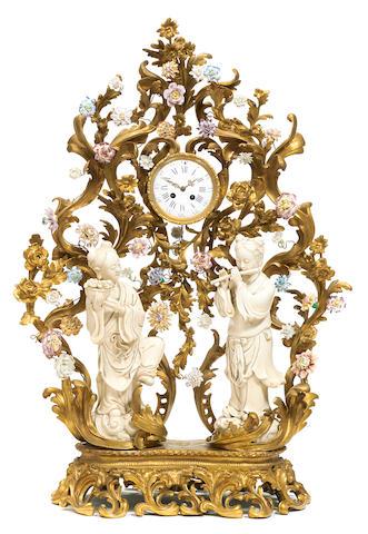 An imposing gilt bronze and porcelain mantel clock