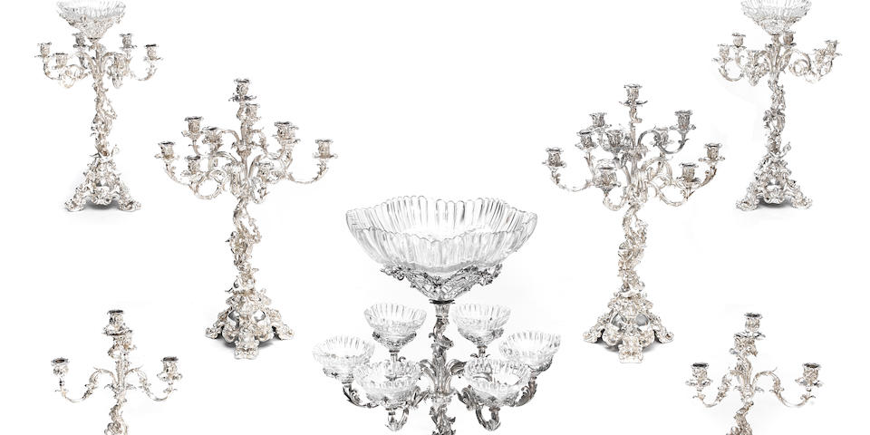 A large Victorian  silver-plated Rococo style seven-piece table garniture no maker's mark evident,  late 19th century