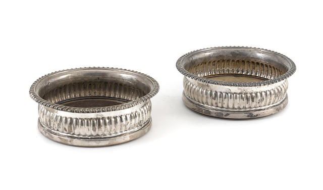 A pair of George III sterling silver  bottle coasters by John & Thomas Settle, Sheffield,  1817