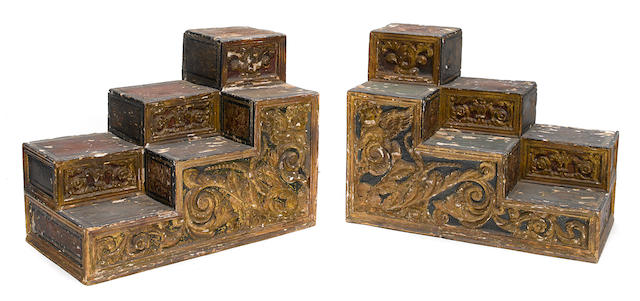 A pair of Baroque style parcel gilt paint decorated stepped shelves