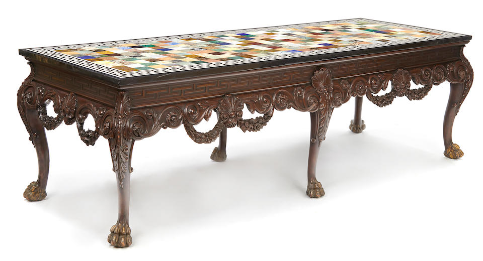 A monumental George II style parcel gilt and paint decorated carved mahogany center table circa 1900
