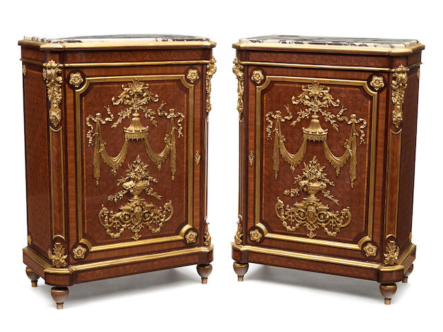A pair of Louis XVI style gilt bronze mounted parquetry inlaid side cupboards