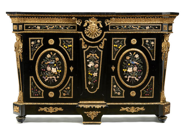 An imposing Napoleon III gilt bronze mounted and polished hardstone ebonized cabinet third quarter 19th century