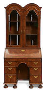 A Queen Anne walnut secretary cabinet early 18th century