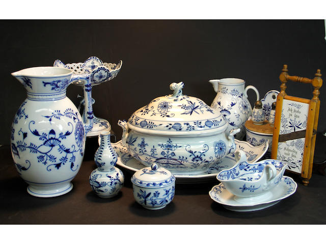 A large Meissen and C. Teichert  porcelain assembled dinner service in the Blue Onion pattern