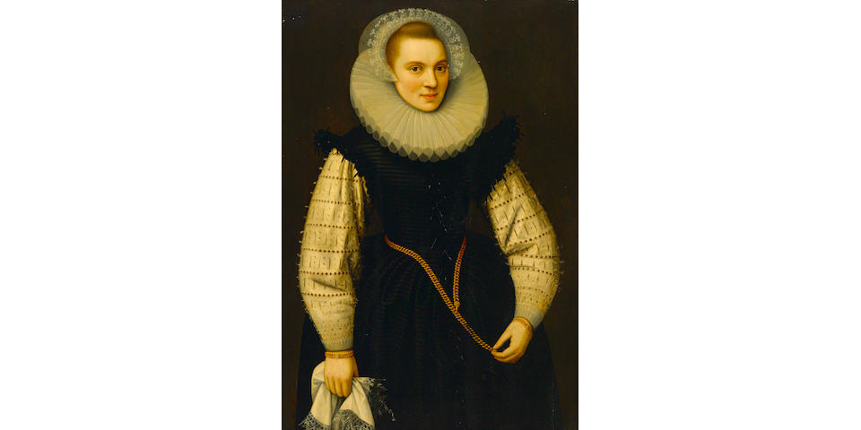 Circle of Gortzius Geldorp (Louvain 1553-1618 Cologne) A portrait of a lady, three-quarter length, holding a handkerchief in her right hand, and wearing matching gold bracelets and an ornate gold chain about her waist 14 1/2 x 28 3/4in (103 x 73cm)
