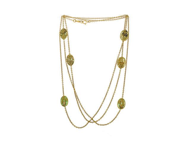 An art nouveau eighteen karat gold and enamel long chain,