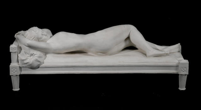 A Sèvres bisque porcelain figure of a reclining nude after a model by Alfred Boucher (French, 1850-1934) dated 1911