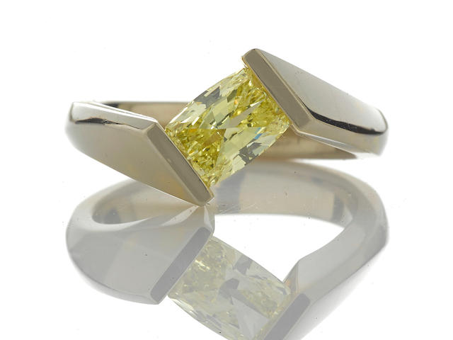 A fancy intense yellow diamond solitaire ring