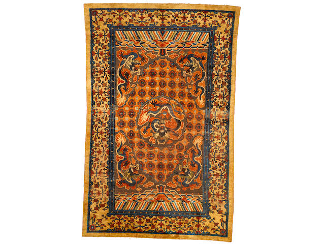 A silk and metal Chinese rug China size approximately 5ft. 11in. x 9ft. 5in.