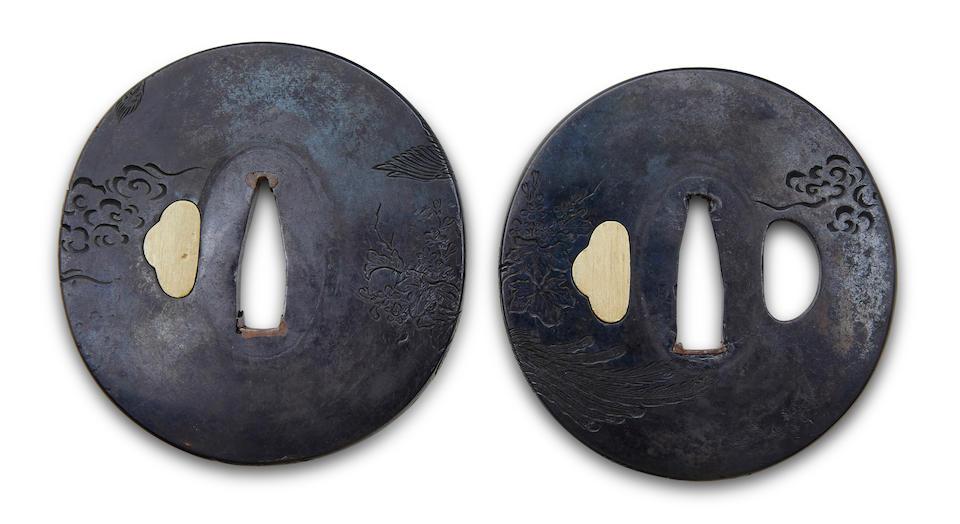 A shakudo daisho pair of tsuba By Aoyanagi Nagamitsu, Edo period (19th century)